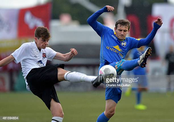 Sean Gannon of Dundalk and Mikhail Hardzeichuk of BATE Borisov during the Champions League 2nd round qualifying game at Oriel Park on July 22 2015 in...