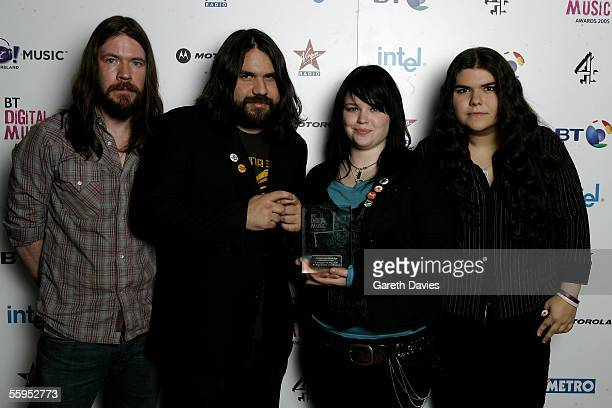 Sean Gannon Romeo Stodart Angela Gannon and Michele Stodart of The Magic Numbers pose with the award for Soundtrack of 2005 for 'Love Me Like You' in...