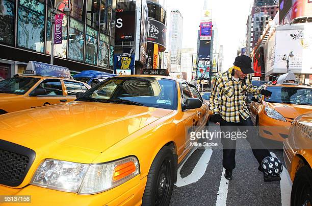 Sean Garnier of France 2008 Red Bull Street style soccer world champion poses for a photo in Time Square during a New York City tour on November 17...