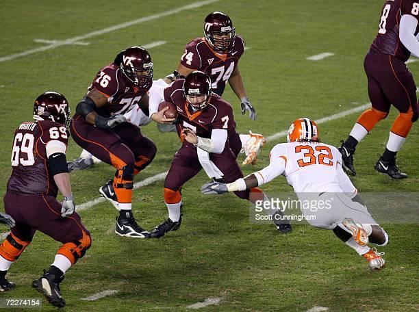 Sean Glennon of the Virginia Tech Hokies scrambles against Nick Watkins of the Clemson Tigers on October 26 2006 at Lane Stadium in Blacksburg...