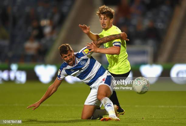 Sean Goss of Queens Park Rangers is tackled by Alex Woodyard during the Carabao Cup First Round match between Queens Park Rangers and Peterborough...