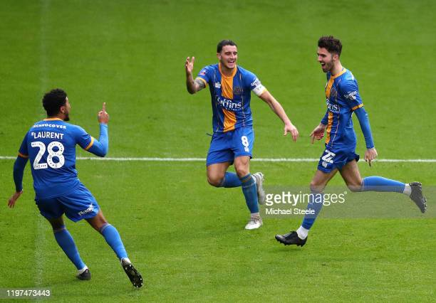 Sean Goss of Shrewsbury Town celebrates with Oliver Norburn and Josh Laurent after scoring his team's first goal during the FA Cup Third Round match...