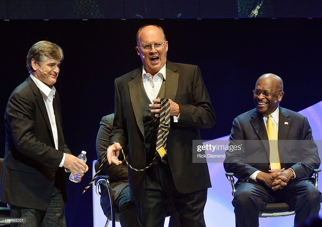 Sean Hannity, Honoree Neal Boortz and Herman Cain attend The Boortz Happy Ending at The Fox Theater on January 12, 2013 in Atlanta, Georgia.
