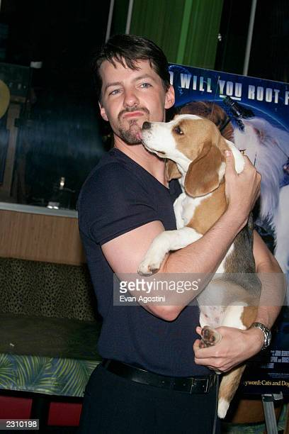 Sean Hayes with Julie the beagle at a 'Cats Dogs' screening at Planet Hollywood Times Square in New York City Photo Evan Agostini/Getty Images