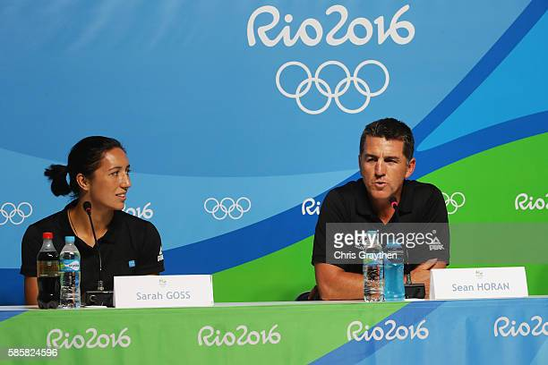 Sean Horan the coach of the New Zealand Women's national rugby sevens team talks alongside player Sarah Goss while attending a press conference on...