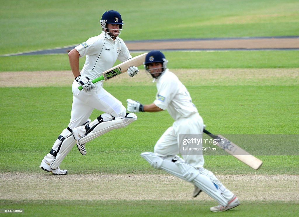 Sean Irvine and Neil McKenzie of Hampshire chase down the Nottinghamshire toatal during the LV County Championship match between Nottinghamshire and Hampshire at Trent Bridge on May 20, 2010 in Nottingham, England.