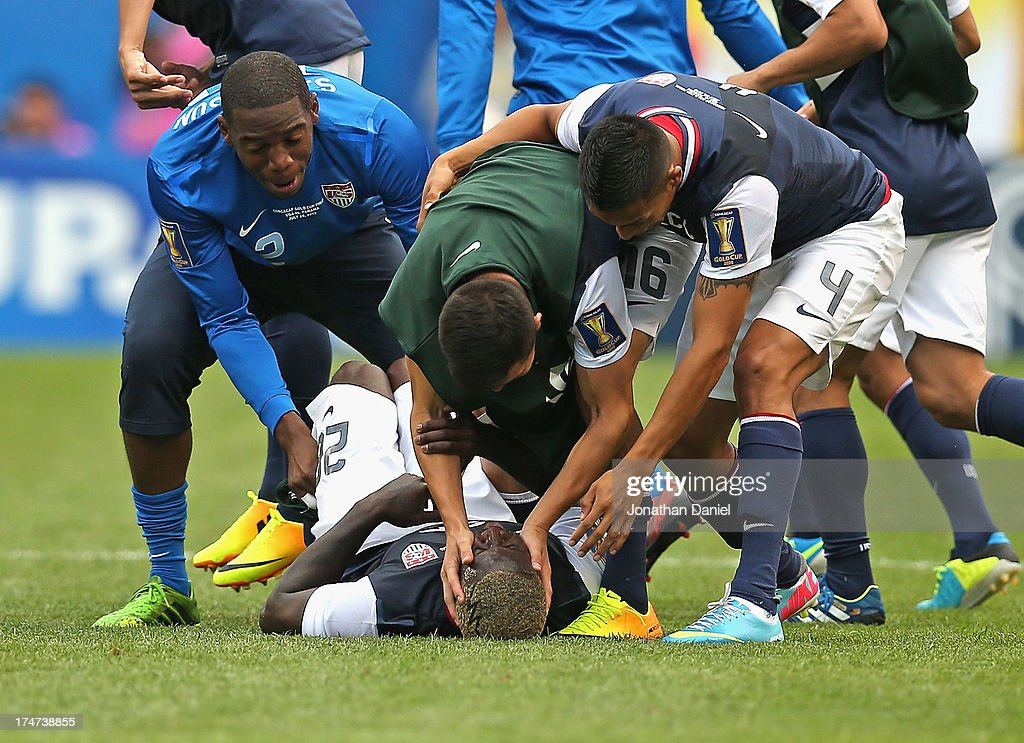 Sean Johnson #12, Jose Torres #16 and Michael Orozco #4 of the United States congratulate Eddie Johnson #26 (on ground) after a win over Panama during the CONCACAF Gold Cup final match at Soldier Field on July 28, 2013 in Chicago, Illinois. The United States defeated Panama 1-0.