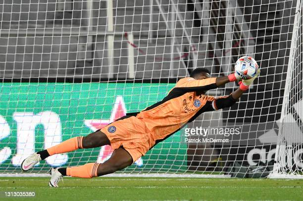 Sean Johnson of New York City FC makes a save against D.C. United in the first half at of the MLS match Audi Field on April 17, 2021 in Washington,...