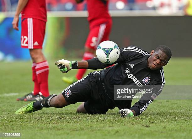 Sean Johnson of the Chicago Fire angered by a goal scored in the 90th minute by the Houston Dynamo knocks the ball back into the net during an MLS...