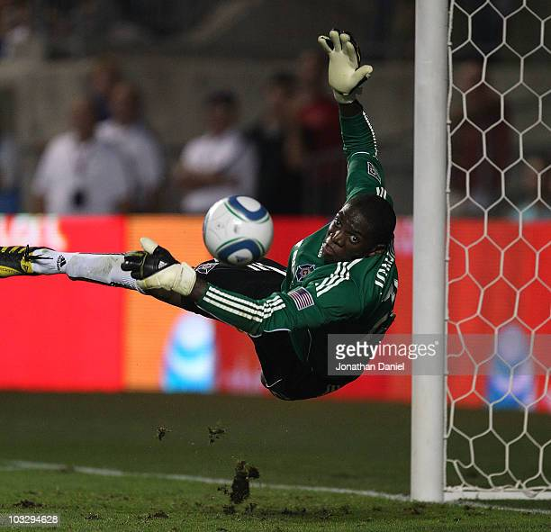 Sean Johnson of the Chicago Fire dives to make a save against the New York Red Bulls in an MLS match on August 8, 2010 at Toyota Park in Bridgeview,...