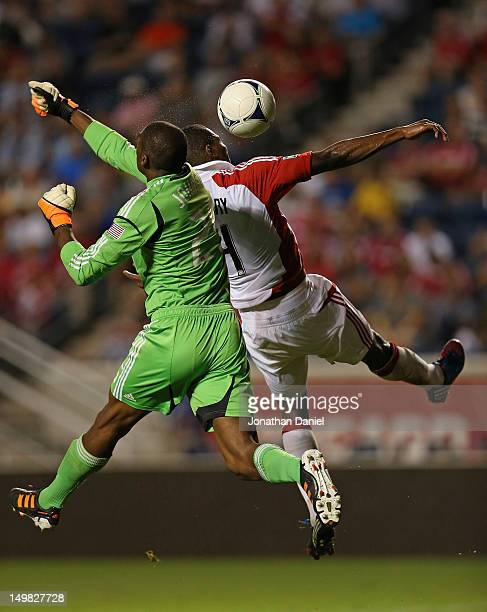 Sean Johnson of the Chicago Fire leaps to punch a shot away by Doneil Henry of Toronto FC during an MLS match at Toyota Park on August 4 2012 in...