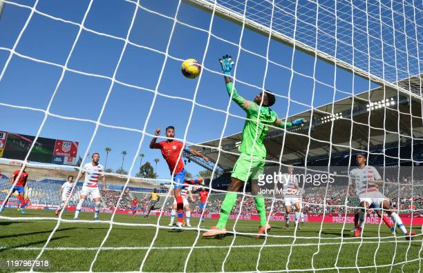 Sean Johnson of the United States looks up as a shot is deflected by the top rail of the goal while playing Costa Rica at Dignity Health Sports Park...