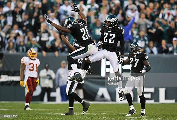 Sean Jones and Asante Samuel of the Philadelphia Eagles celebrate holding off the Washington Redskins during the final drive of their game, winning...