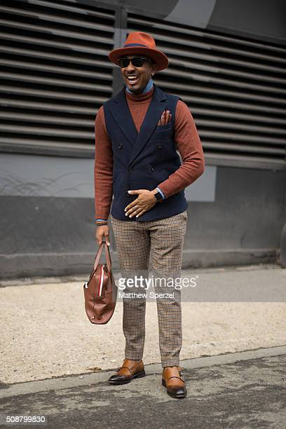 Sean Julian is seen at Skylight Clarkson North wearing vintage hat Suitsupply pants and vest Topman sweater Ben Minkoff bag Canali shoes Zara gloves...