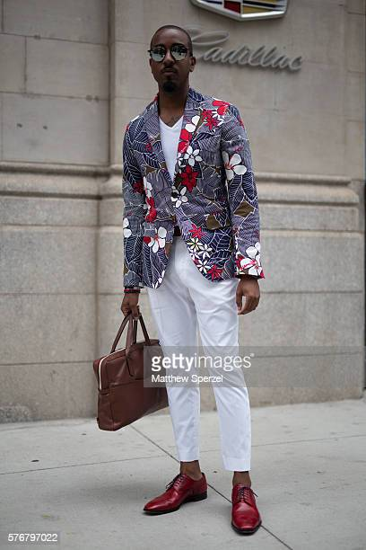 Sean Julian is seen attending the KATAMA presentation wearing a B Squared jacket Ben Minkoff bag and Christian Louboutin shoes during New York...