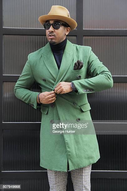 Sean Julian seen at Industria Superstudios wearing black and white checked Suit Supply pants green SGen pea coat black Zara polar neck top RaBan...