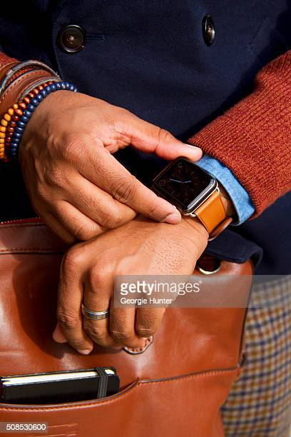 Sean Julian seen at Skylight Clarkson Sq outside the Orley show wearing Suit Supply pants jacket and shirt Ben Minkoff brown leather bag and iWatch...