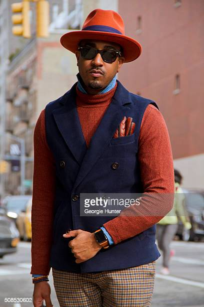 Sean Julian seen at Skylight Clarkson Sq outside the Orley show wearing Suit Supply pants jacket and shirt vintage orange hat with purple ribbon...