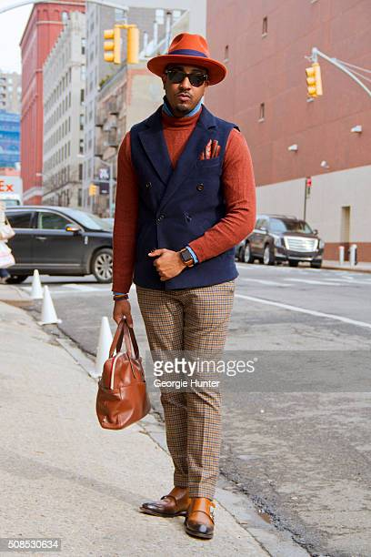 Sean Julian seen at Skylight Clarkson Sq outside the Orley show wearing Suit Supply pants jacket and shirt vintage orange hat with purple ribbon Ben...