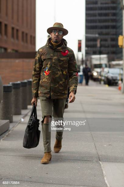 Sean Julian wears a Tole camoflage jacket outside New York Men's Day at Dune Studios on January 30 2017 in New York City