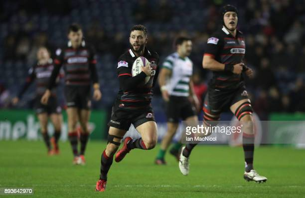 Sean Kennedy of Edinburgh ibreaks away to score his sides sixth try during the European Rugby Challenge Cup match between Edinburgh and Krasny Yar at...