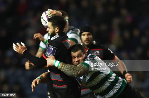 Sean Kennedy of Edinburgh is tackled by Oleg Prepelitse of Krasny Yar during the European Rugby Challenge Cup match between Edinburgh and Krasny Yar...