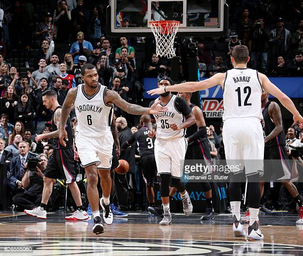 Sean Kilpatrick and Joe Harris of the Brooklyn Nets shake hands during the game against the LA Clippers on November 29 2016 at Barclays Center in...