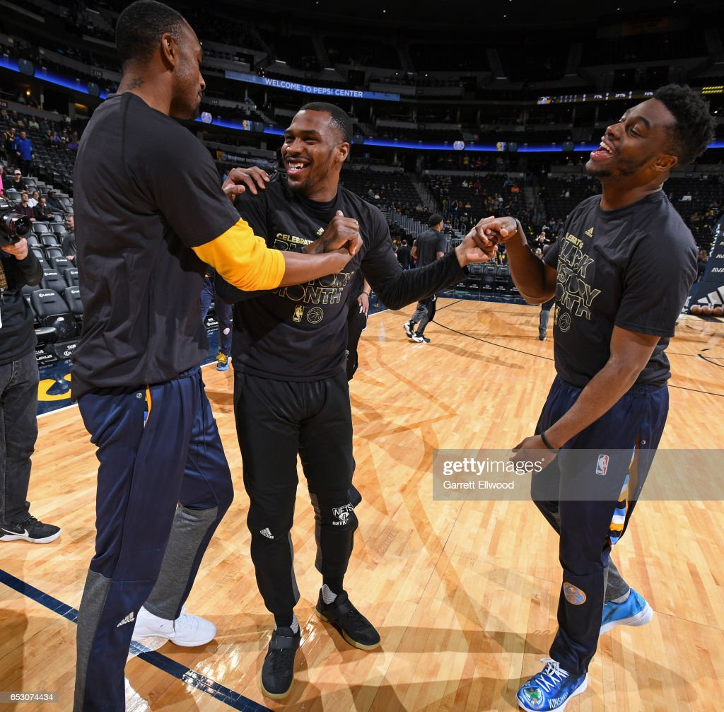 Sean Kilpatrick #6 of the Brooklyn Nets, Emmanuel Mudiay #0, and Darrell Arthur #00 of the Denver Nuggets talk before the game on February 24, 2017 at the Pepsi Center in Denver, Colorado.