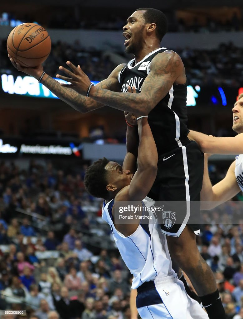 Sean Kilpatrick #6 of the Brooklyn Nets is called for a charge against Yogi Ferrell #11 of the Dallas Mavericks in the first half at American Airlines Center on November 29, 2017 in Dallas, Texas.