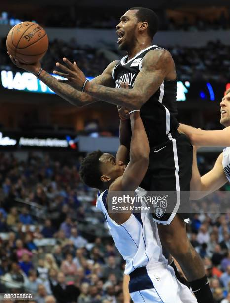 Sean Kilpatrick of the Brooklyn Nets is called for a charge against Yogi Ferrell of the Dallas Mavericks in the first half at American Airlines...