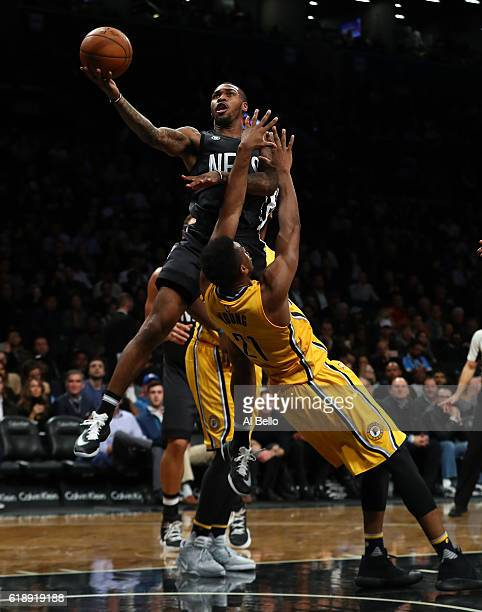 Sean Kilpatrick of the Brooklyn Nets shoots against Thaddeus Young of the Indiana Pacers during their game at the Barclays Center on October 28 2016...