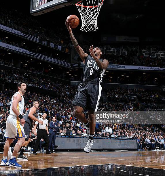 Sean Kilpatrick of the Brooklyn Nets shoots during a game against the Golden State Warriors on December 22 2016 at Barclays Center in Brooklyn NY...