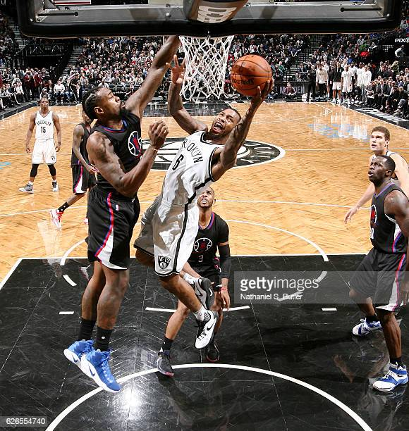 Sean Kilpatrick of the Brooklyn Nets shoots the ball against DeAndre Jordan of the LA Clippers during the game on November 29 2016 at Barclays Center...