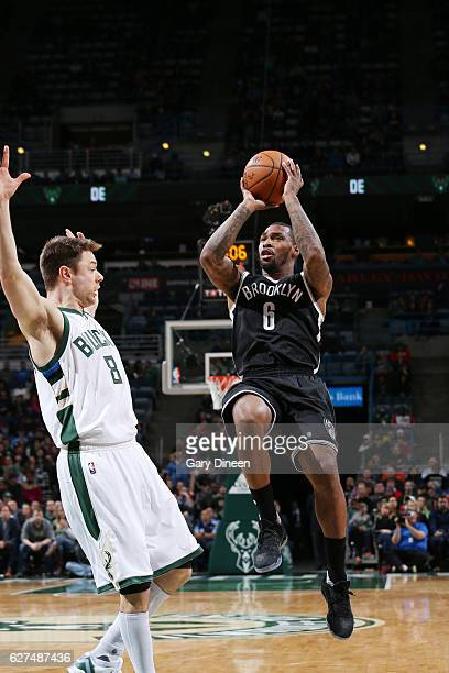 Sean Kilpatrick of the Brooklyn Nets shoots the ball against Matthew Dellavedova of the Milwaukee Bucks during the game on December 3 2016 at the BMO...