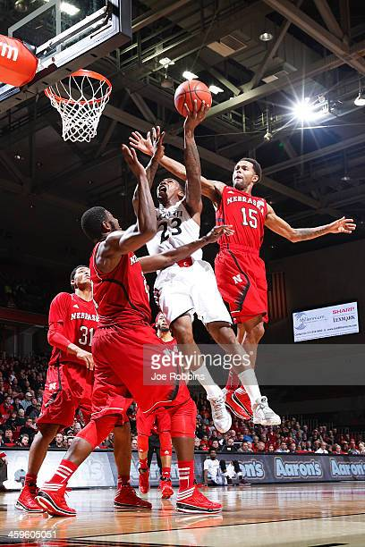 Sean Kilpatrick of the Cincinnati Bearcats drives to the basket against Ray Gallegos and Leslee Smith of the Nebraska Cornhuskers during the game at...