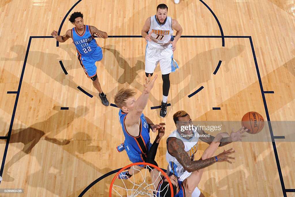 Sean Kilpatrick #6 of the Denver Nuggets drives to the basket against the Oklahoma City Thunder on January 19, 2016 at the Pepsi Center in Denver, Colorado.