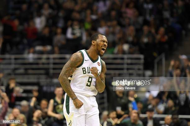 Sean Kilpatrick of the Milwaukee Bucks reacts to a score during a game against the Charlotte Hornets at the Bradley Center on December 22 2017 in...