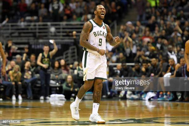 Sean Kilpatrick of the Milwaukee Bucks reacts to a score during the second half of a game against the Charlotte Hornets at the Bradley Center on...