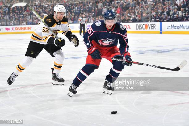 Sean Kuraly of the Boston Bruins and Matt Duchene of the Columbus Blue Jackets skate after a loose puck during the second period in Game Three of the...
