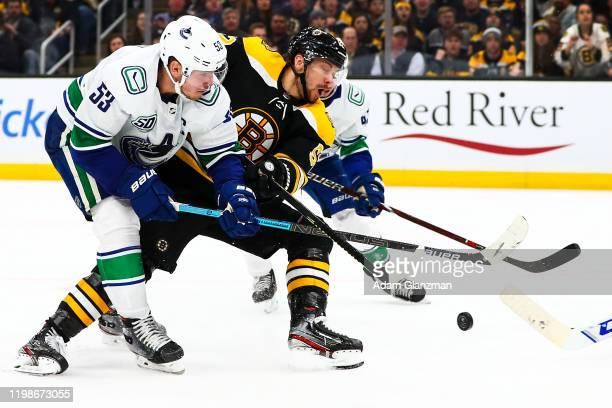 Sean Kuraly of the Boston Bruins battles for the puck during a game against the Vancouver Canucks at TD Garden on February 4, 2020 in Boston,...