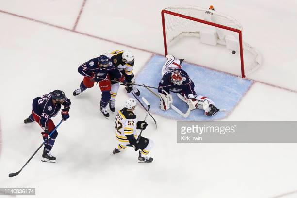 Sean Kuraly of the Boston Bruins beats Sergei Bobrovsky of the Columbus Blue Jackets for a goal during the third period in Game Four of the Eastern...