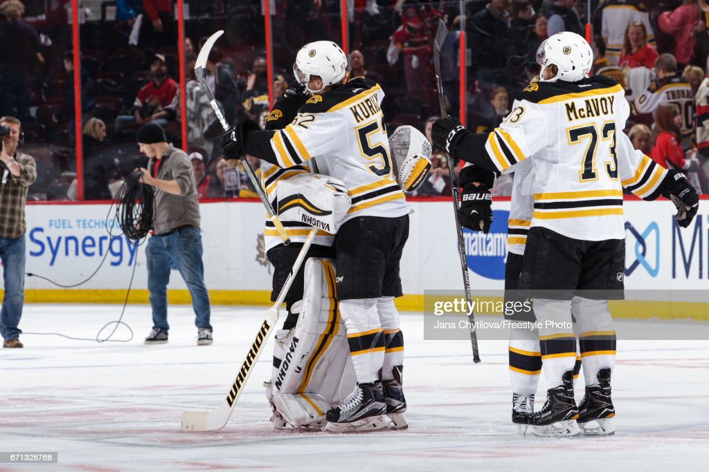 Sean Kuraly #52 of the Boston Bruins celebrate their second period overtime win against the Ottawa Senators with teammates Tuukka Rask #40, and Charlie McAvoy #73 in Game Five of the Eastern Conference First Round during the 2017 NHL Stanley Cup Playoffs at Canadian Tire Centre on April 21, 2017 in Ottawa, Ontario, Canada.