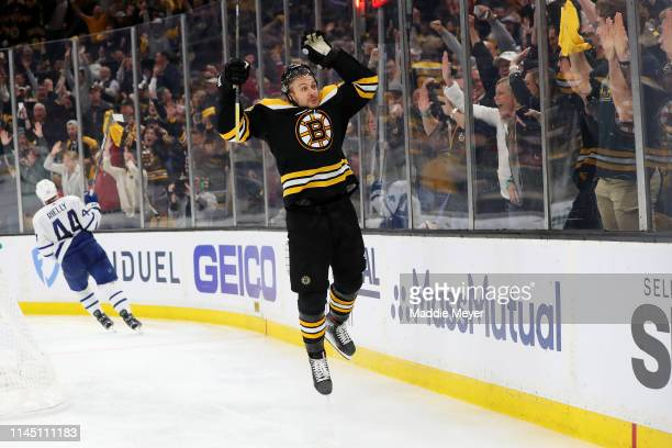 Sean Kuraly of the Boston Bruins celebrates after scoring a goal during the third period of Game Seven of the Eastern Conference First Round against...