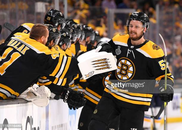 Sean Kuraly of the Boston Bruins celebrates his goal with teammates during the third period of Game One of the 2019 Stanley Cup Finals against the...