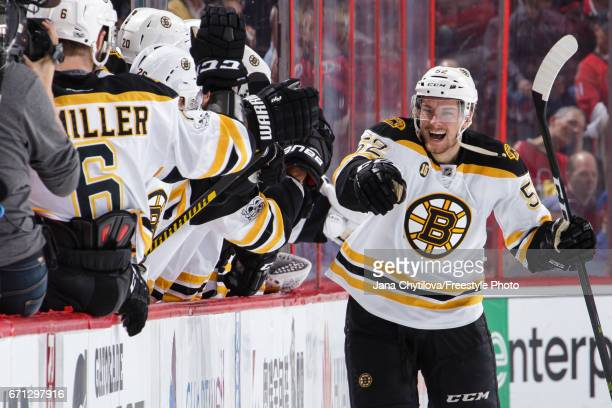 Sean Kuraly of the Boston Bruins celebrates his second period goal against the Ottawa Senators with teammates on the bench in Game Five of the...