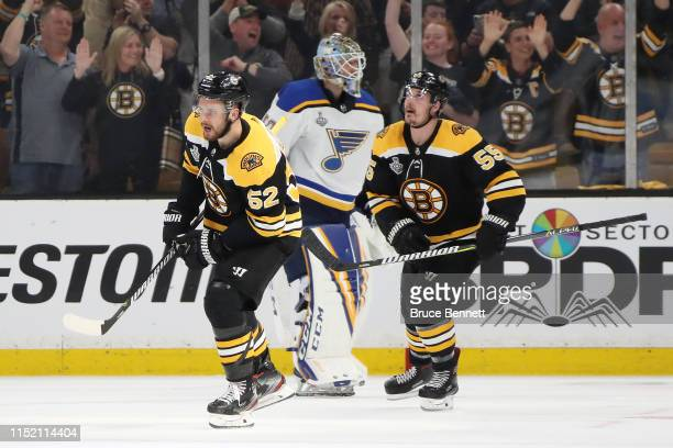 Sean Kuraly of the Boston Bruins celebrates his third period goal against as Jordan Binnington of the St. Louis Blues reacts in Game One of the 2019...