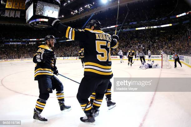 Sean Kuraly of the Boston Bruins celebrates with Kevan Miller after scoring a goal during the third period of Game One of the Eastern Conference...