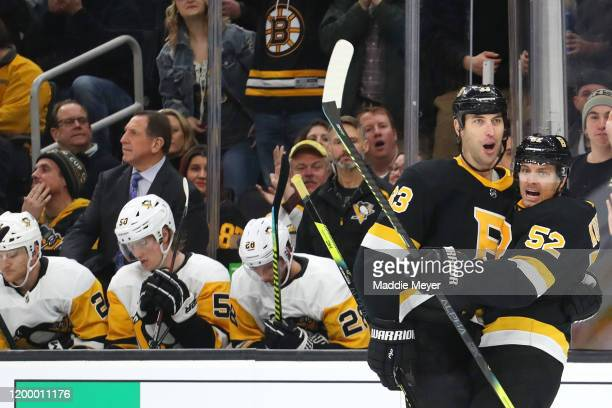 Sean Kuraly of the Boston Bruins celebrates with Zdeno Chara after scoring a goal against the Pittsburgh Penguins during the first period at TD...