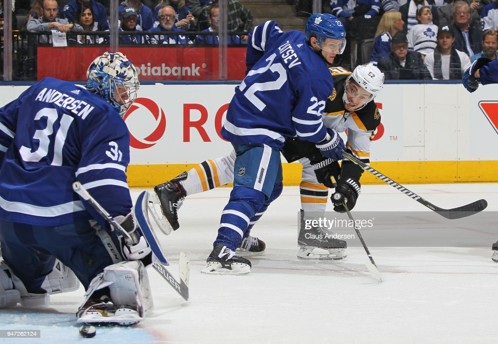 Sean Kuraly #52 of the Boston Bruins, checked by Nikita Zaitsev #22 of the Toronto Maple Leafs, fires a shot at goalie Frederik Andersen #31 in Game Three of the Eastern Conference First Round during the 2018 Stanley Cup Play-offs at the Air Canada Centre on April 16, 2018 in Toronto, Ontario, Canada. The Maple Leafs defeated the Bruins 4-2.