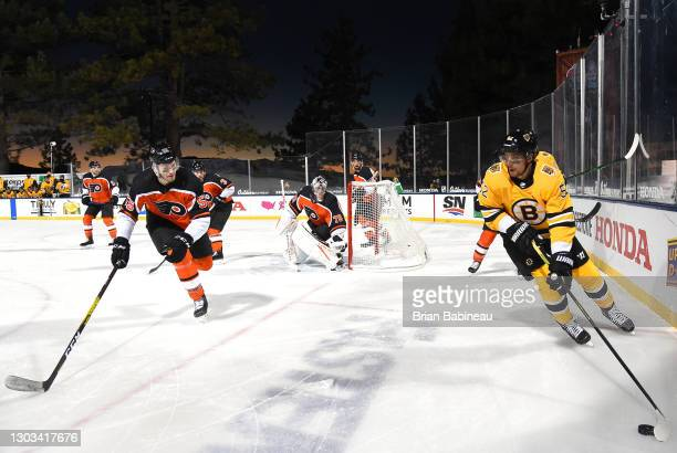 Sean Kuraly of the Boston Bruins controls the puck in the corner against Samuel Morin of the Philadelphia Flyers during the second period of the 2021...
